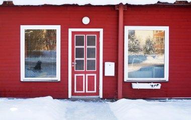 Red door in wintertime