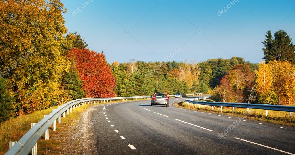 cars moving on a highway road