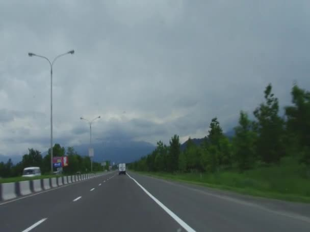 Trip by car on the road in the foothills of main Caucasus Mountain Range