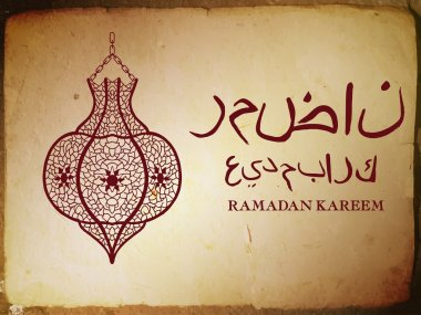 Traditional lantern with arabic calligraphy which means Ramadan  and Blessed holiday.