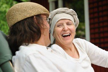 senior woman laughs at joke