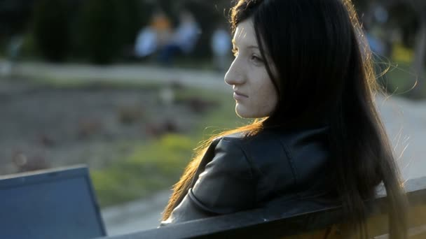 Portrait of a Young Woman Who Looked Left Then Looks to the Laptop. She is Worried, Sad, Can Not Concentrate.