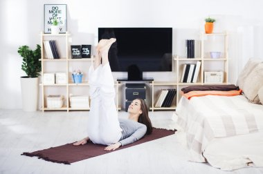 Woman is doing fitness at home