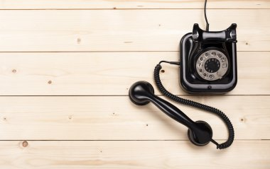 Old retro black phone on wooden board, top view, DOF, focus on phone stock vector