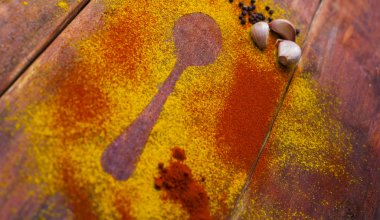 Spices powder on wooden board