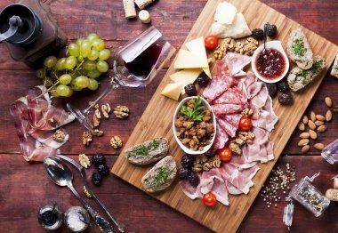Prosciutto, cheese, grapes, red wine