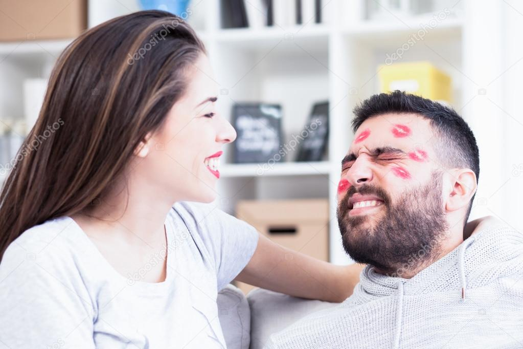 Valentines Couple Woman Kissing Man With Red Lipstick All Over His Face,Shallow Depth Of Field -2799