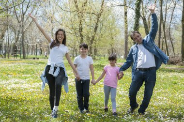 Mother and father with children in park