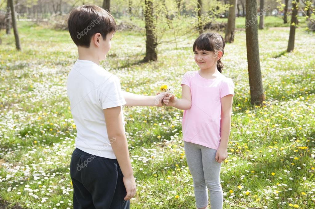 Boy giving girl  flower
