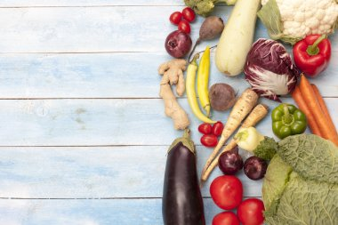 Vegetables on a blue wooden board, top view