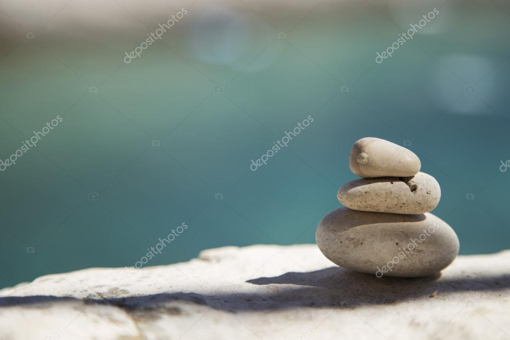 Stones and rocks balance on the beach