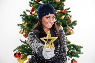 Young woman preparing gifts for Christmas, studio shots
