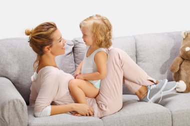 Mother playing with daughter in livingroom