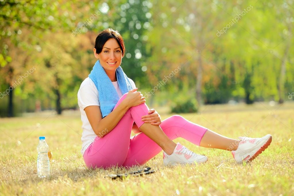 woman resting after exercising in park