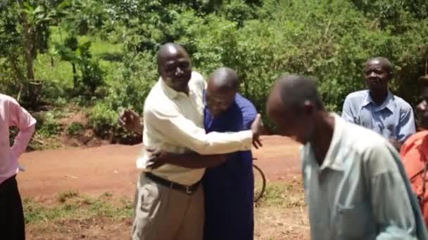 African men celebrating the installation of a new water well in rural Masindi, Uganda, September 2013