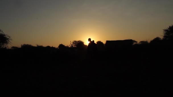 African sunrise in Tanzania with Maasai tribe