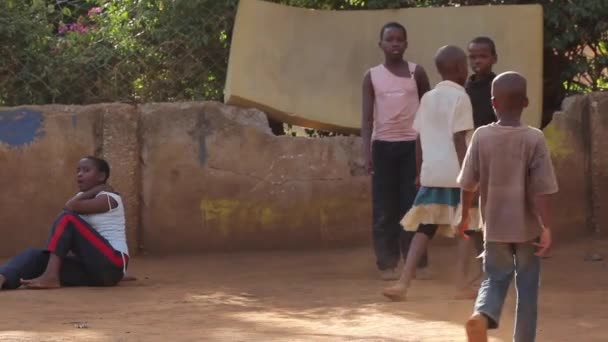 A group of African kids playing in the school playground, Kenya, March 2013