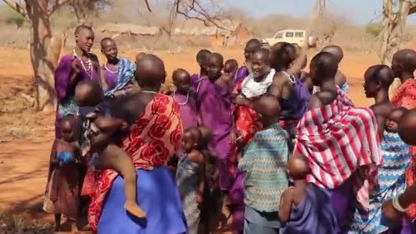 Children from Maasai Mara tribe in Tanzania singing and dancing, March 2013