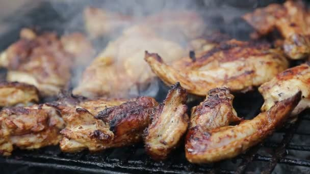 Chicken meat on barbeque grill