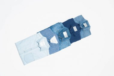 Flat lay of blue denim shirts on white background, top view stock vector