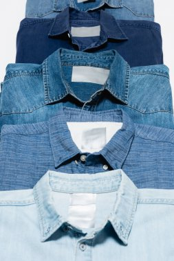 Close up view of different denim shirts isolated on white stock vector