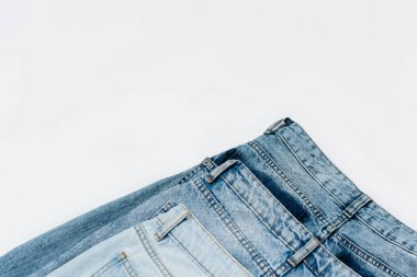 Pair of blue jeans isolated on white with copy space, top view stock vector