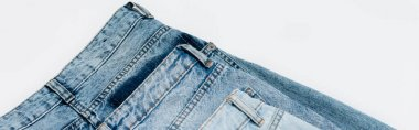 Different classic jeans isolated on white, top view, banner stock vector