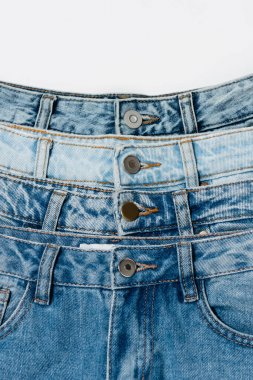 Close up view of various blue jeans isolated on white, top view stock vector