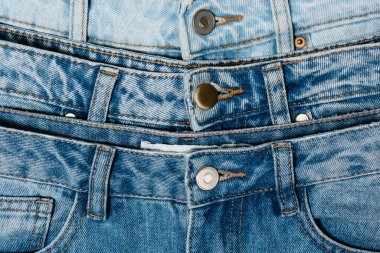 Close up view of various blue jeans stock vector