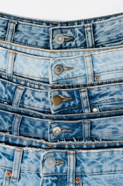 Closed up view of various blue jeans isolated on white stock vector