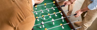 Cropped view of business people playing table soccer, banner stock vector
