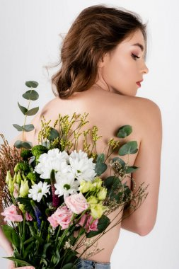 Side view of shirtless woman holding bouquet of chrysanthemums and eustoma isolated on grey stock vector