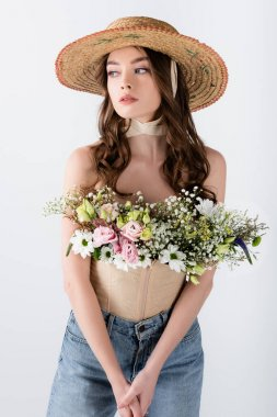 Model in sun hat with flowers in blouse isolated on grey stock vector