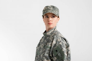 Soldier in uniform looking away isolated on grey stock vector