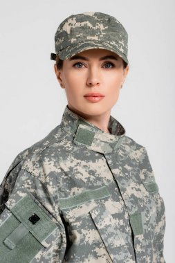 Portrait of military woman looking at camera isolated on grey stock vector