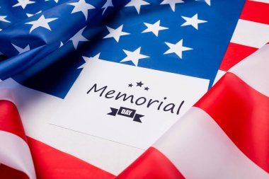 Memorial day lettering on card on american flag stock vector