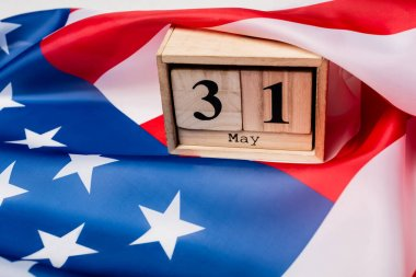 Wooden calendar with 31 may date on american flag stock vector