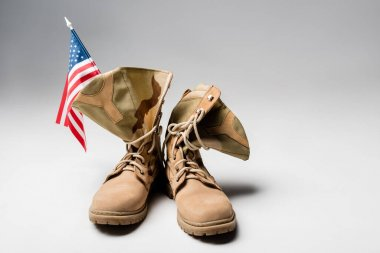 American flag and military boots on grey background stock vector