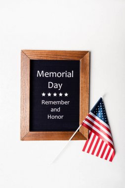 Top view of american flag and chalkboard with memorial day remember and honor lettering on white background stock vector