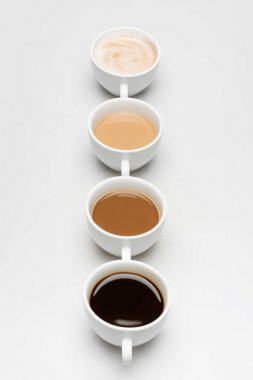Different prepared coffee drinks with milk on white stock vector