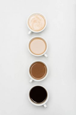 Top view of different freshy made coffee drinks with milk on white stock vector