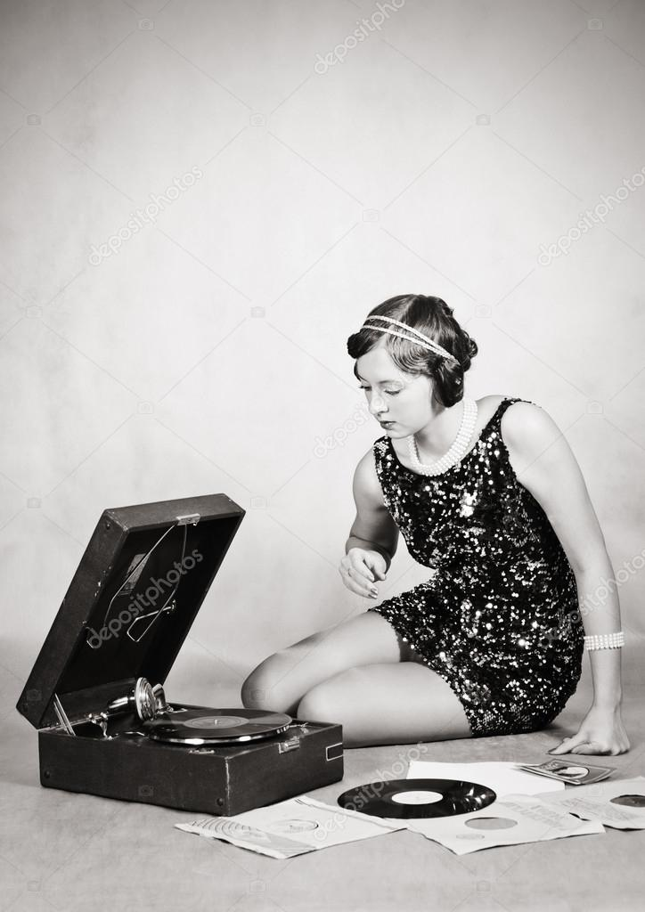 Girl listening to gramophone records. Vintage ⬇ Stock Photo, Image by ©  Vadyuhin #95830116