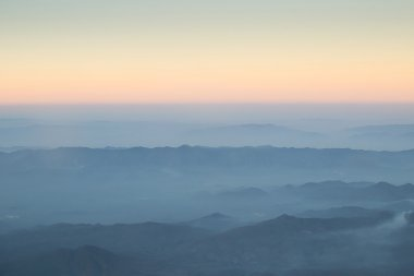 Layer of clouds fog mountain and sunrise.