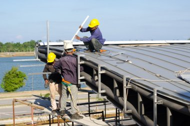Construction worker roof installation