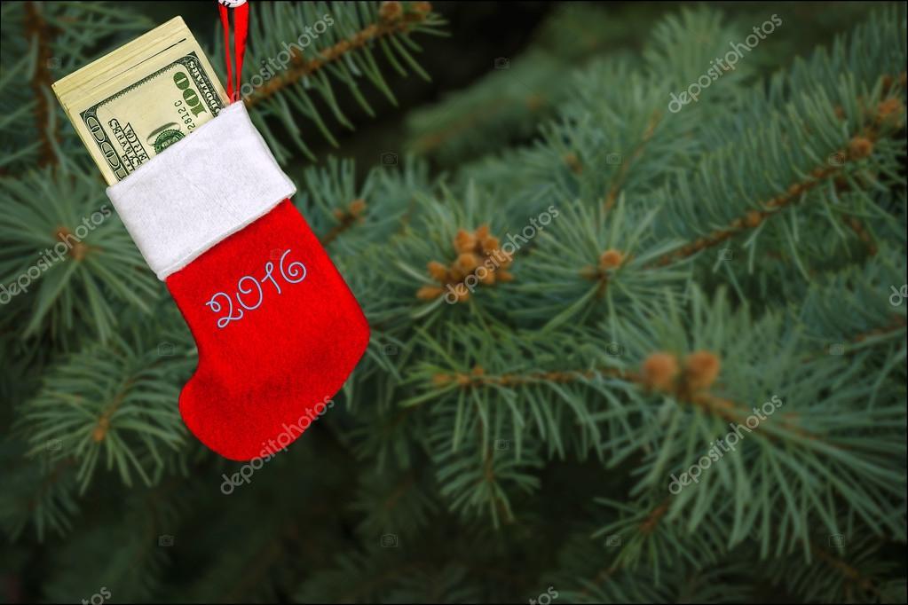 Christmas Tree Bill.Red Stocking Full With Dollar Bills Christmas Tree Stock