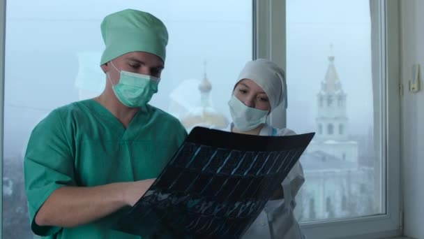 Surgeon and Nurse Arguing the X-Ray Picture