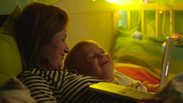 Boy and Mother Watching Bedtime Story in Laptop