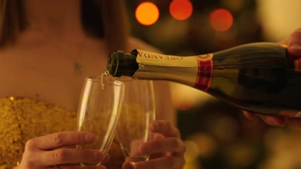 Pouring Champagne to Glasses to Toast the Christmas