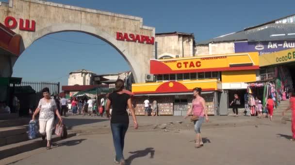 People enter the Osh bazaar