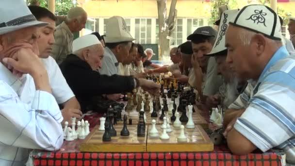 Kyrgyz men play chess